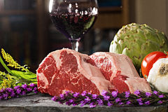 Thick cut, juicy, raw New York steaks Royalty Free Stock Photo
