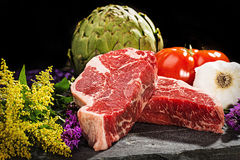 Thick cut, juicy, raw New York steaks Stock Image