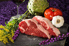 Thick cut, juicy, raw New York steaks Stock Photography