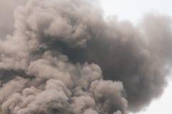 Thick dark smoke Stock Images
