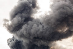 A thick and dark smoke flooding the street of a city Royalty Free Stock Photo