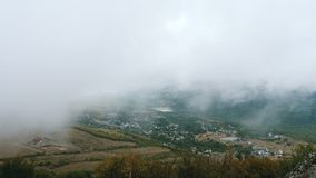 Clouds float above the mountain village. stock footage