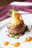 Thick filet mignon. Grilled bbq steak with potato cube.Thick filet mignon Royalty Free Stock Photography