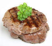 Thick Fillet Steak. Freshly griddled fillet steak, with visible seasoning, resting on a white plate (not isolated Stock Photos