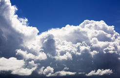 Thick fluffy clouds high in the sky, the landscape. Royalty Free Stock Photos