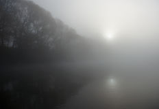 Thick fog over a river in fall Royalty Free Stock Images