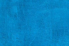 Thick fresh blue oil paint on flat steel surface seamless texture with old cracks under it.  stock images