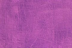 Thick fresh pink oil paint on flat steel surface seamless texture with old cracks under it.  stock photo
