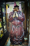 Thick Friar at the door of a restaurant, vintage doll claim traditional food stock photography