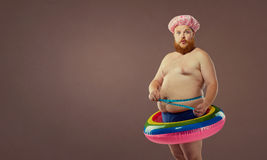 Thick funny man in the inflatable circle Royalty Free Stock Photography