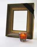 Thick gold picture frame candle. On white Royalty Free Stock Photography