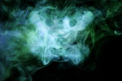 Thick green and blue smoke on a black isolated background. stock illustration