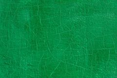 Thick green fresh oil paint on flat steel surface seamless texture with old cracks under it. Thick fresh green oil paint on flat steel surface seamless texture royalty free stock photo