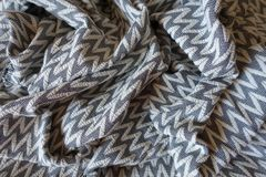 Thick gray patterned fabric in soft folds. Thick grey patterned fabric in soft folds Royalty Free Stock Images