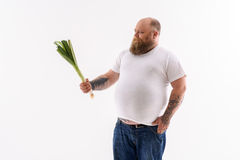 Thick guy do not like healthy food Royalty Free Stock Photography