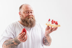 Thick guy does not like healthy food Royalty Free Stock Photos