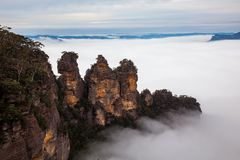 A thick high fog surrounding the iconic Three sisters in katoomba new south wales australia on 16th June 2017 stock photo