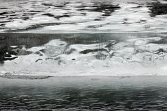Thick ice cracked with round air bubbles abstract Stock Photography