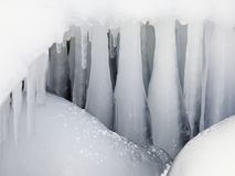 Thick icicles. Reminding a palisade Stock Photos