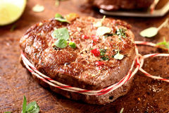 Thick juicy grilled lean beef steak medallions Royalty Free Stock Photos