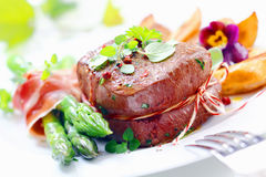 Thick juicy steak with fresh green asparagus Royalty Free Stock Photography