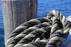 Thick knotted rope at the boat dock Royalty Free Stock Photos