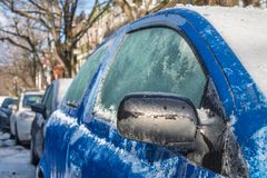 Thick layer of ice covering car stock image