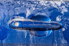 Thick layer of ice covering handle car royalty free stock images