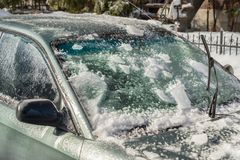 Thick layer of ice covering car royalty free stock photography