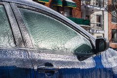 Thick layer of ice covering car stock photo