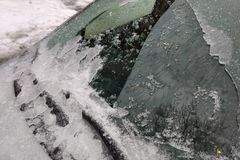 Thick layer of ice covering car after freezing rain royalty free stock photos