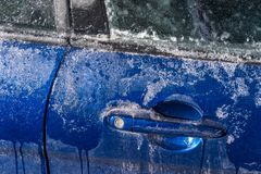Thick layer of ice covering car stock photography