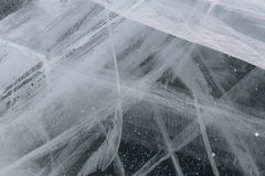 A thick layer of ice in the cracks and bubbles of gas. Stock Photos