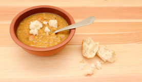 Thick lentil soup with pieces of bread Royalty Free Stock Photography