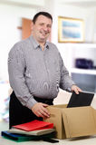 Thick man got a new high-paid occupation Royalty Free Stock Photography