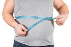 Thick mature man measuring belly blue measuring tape, isolated o stock images