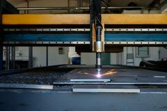 Thick metal cutting plasma cutting machine technology, flame with sparks stock image