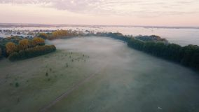 Thick morning fog over the river and meadow. Flying over the mist landscape stock video