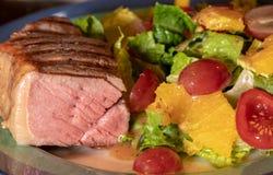 Thick New York Strip steak cooked medium rare Royalty Free Stock Photo
