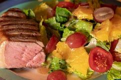 Thick New York Strip steak cooked medium rare Stock Images