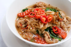 Thick noodle with pork in Thai style. Which can be found in local Thai restaurant Stock Photos