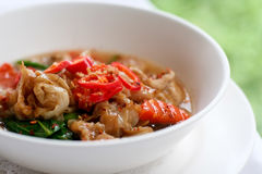 Thick noodle with pork in Thai style. Which can be found in local Thai restaurant Stock Images
