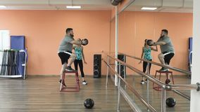 Overweight male and female trainer with perfect body burn calories by workout. Personal training from athletic girl for. Thick obese guy together with personal stock footage