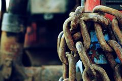 Thick old chain from the tractor with retro effect Royalty Free Stock Photos