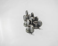 Thick Old Retro Wing Nuts Aligned Pattern On White Background Royalty Free Stock Photo