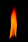 Thick orange flame. Flame over black background with reflection Stock Photo