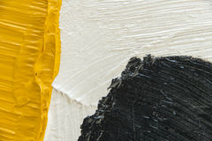 Thick paint brush strokes. Black yellow and white Thick painted background. Copyspace Royalty Free Stock Photos