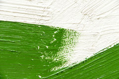 Thick paint brush strokes. Green and white Thick painted background. Copyspace stock image