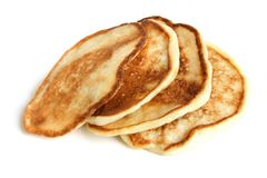 Thick pancakes. On a white background Royalty Free Stock Photography