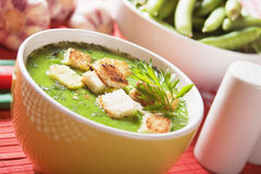 Thick pea soup. Thick green pea vegetable soup with croutons Stock Photos